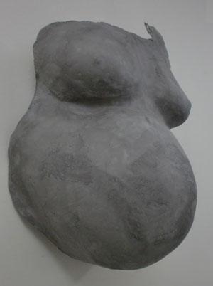 Het vereeuwigen van een zwangere buik.